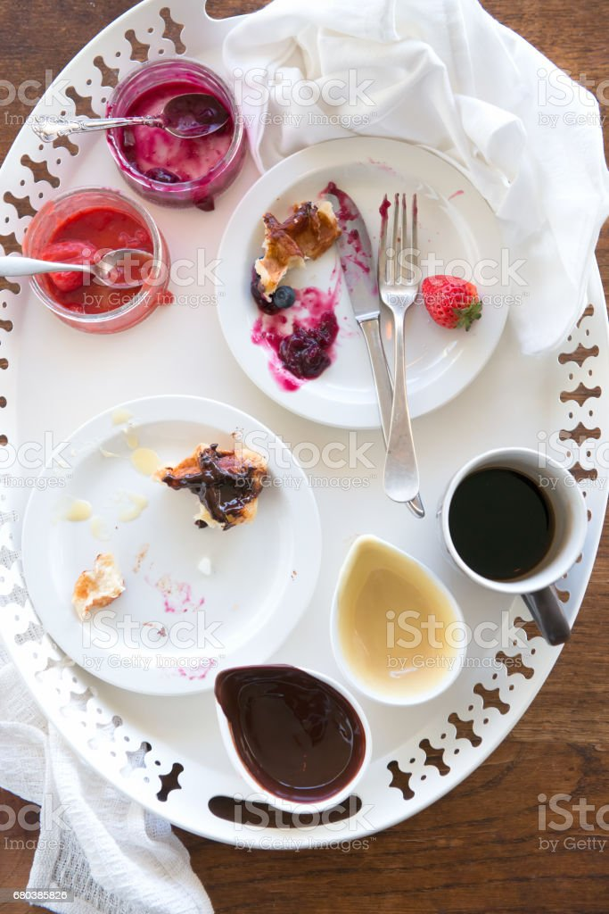 Breakfast Tray with Dirty Dishes, Uneaten Waffles and Unfinished Coffee royalty-free stock photo