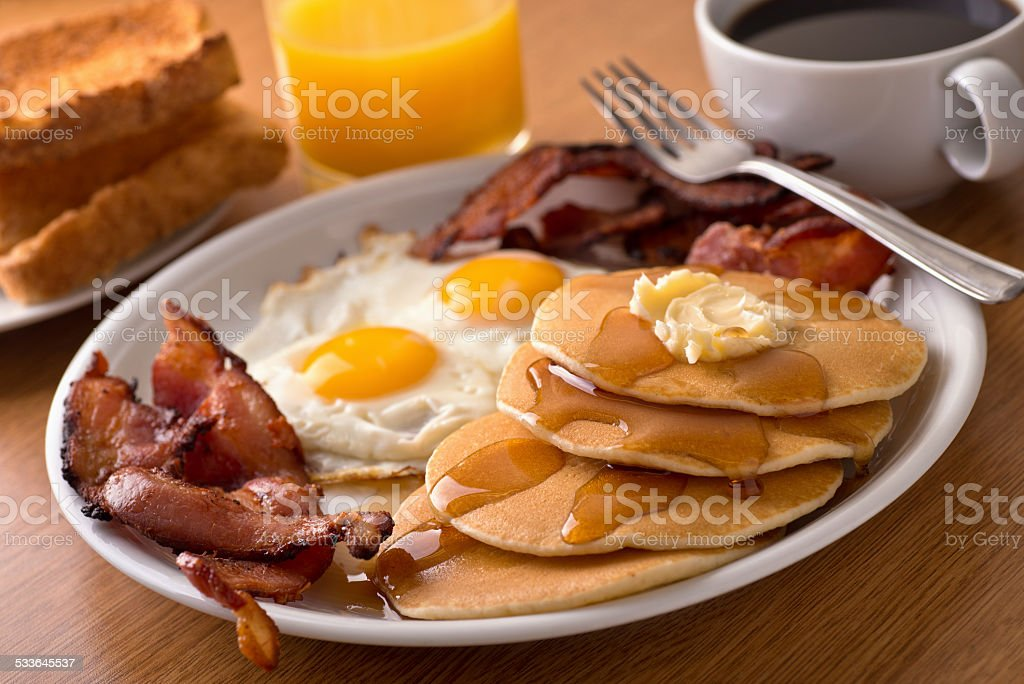 Breakfast with bacon, eggs, pancakes, and toast bildbanksfoto