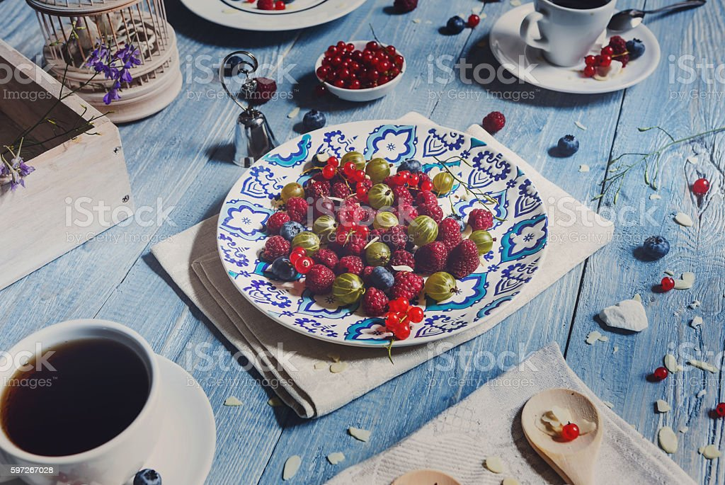 Breakfast with baked pea and berries at blue rustic wood royalty-free stock photo