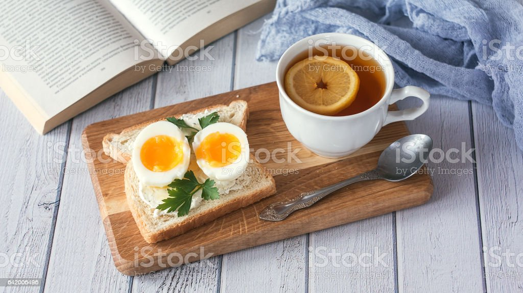 breakfast with boiled eggs and crispy toasts, closeup stock photo