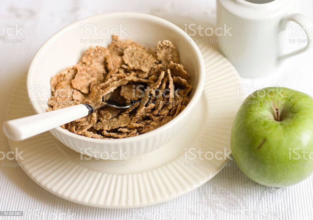 breakfast with bran flakes and apple stock photo