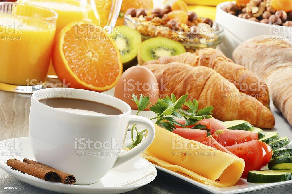 Breakfast with coffee, orange juice, croissant, egg, vegetables stock photo