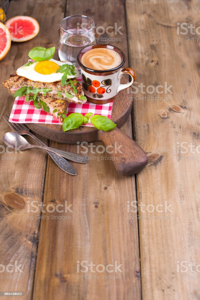 Breakfast with coffee, toasts, butter and jam on wooden background. Copy space - Zbiór zdjęć royalty-free (Anglia)