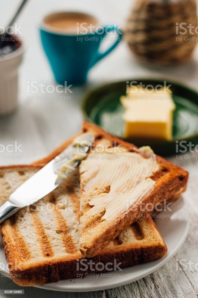Breakfast with coffee, toasts, butter and jam stock photo