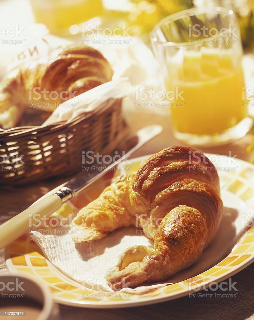 Breakfast with croissant and orange juice with strong DOF royalty-free stock photo