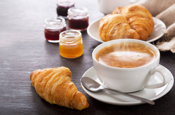 breakfast with cup of coffee and croissants stock photo