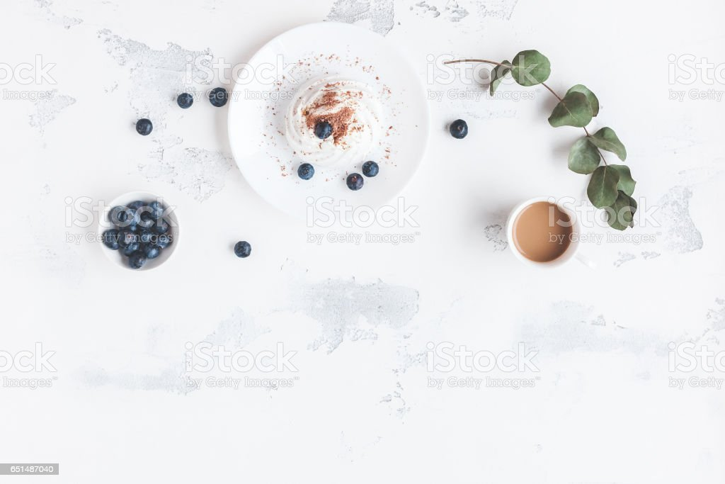 Breakfast with cup of coffee, sweet dessert, blueberry