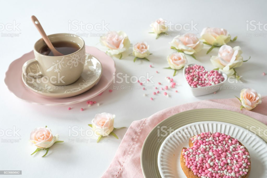 breakfast with cup of tea with crispy rusk with traditional Dutch food pink muisjes, aniseed, roses, or celebration birth of a daughter stock photo