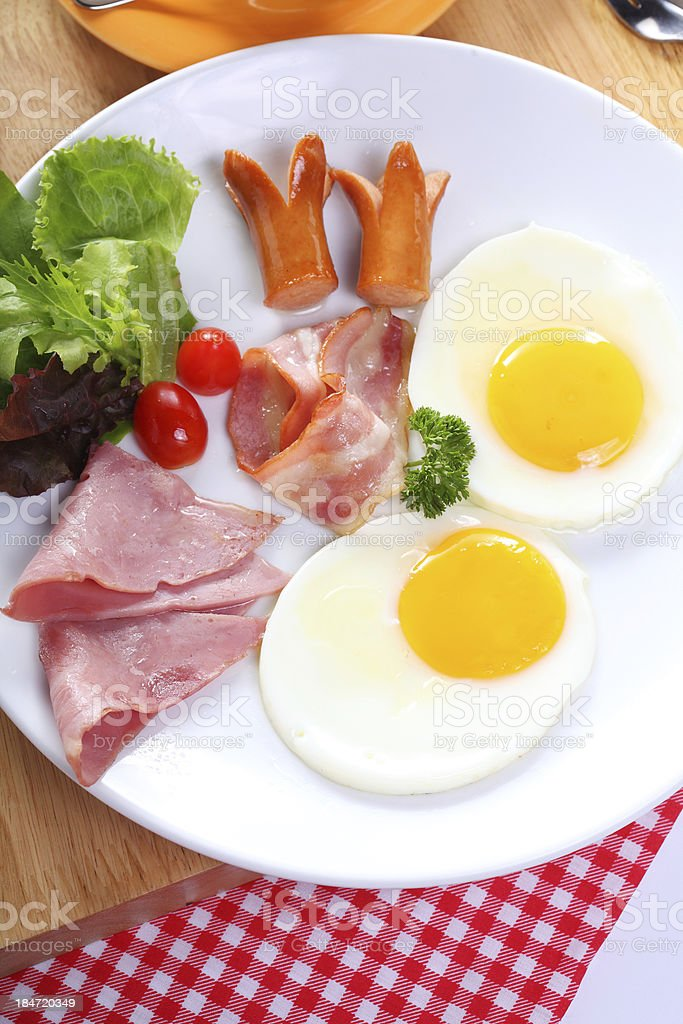 breakfast with egg, ham, bacon, sausage and vegetables royalty-free stock photo