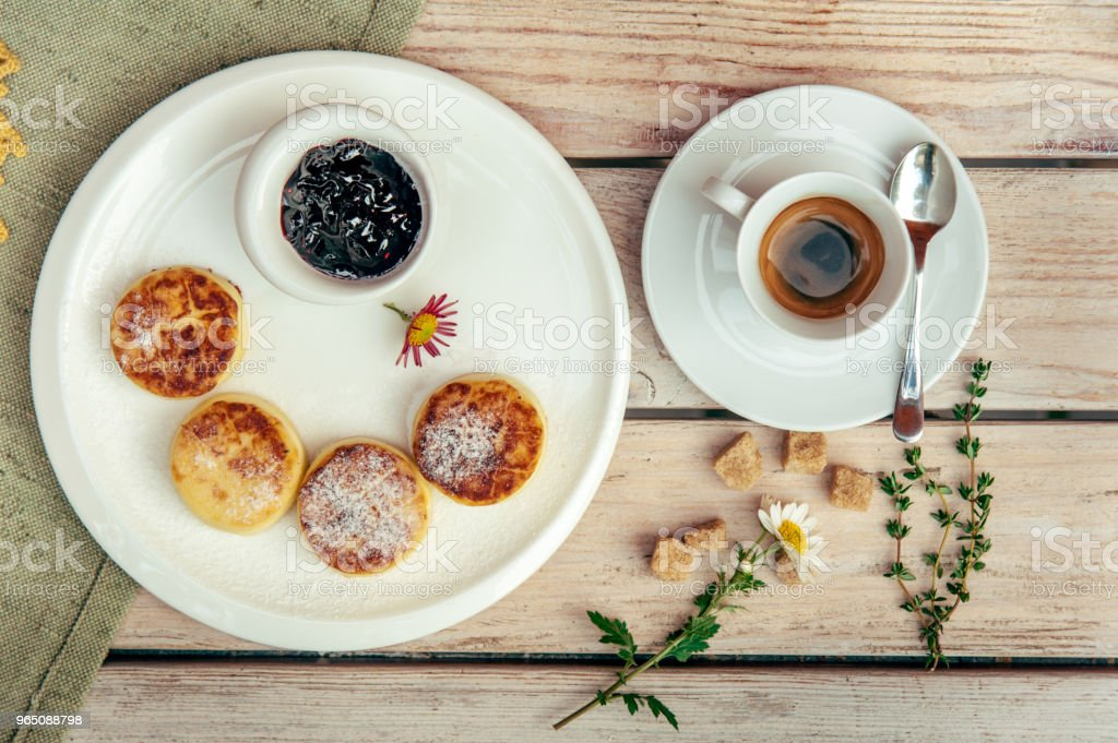 breakfast with four cheese pancakes, black coffee and currant jam zbiór zdjęć royalty-free