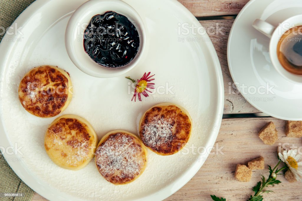 breakfast with four cheese pancakes, black coffee and currant jam royalty-free stock photo