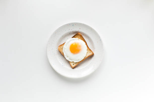 breakfast with fried egg on toast - fried egg stock photos and pictures