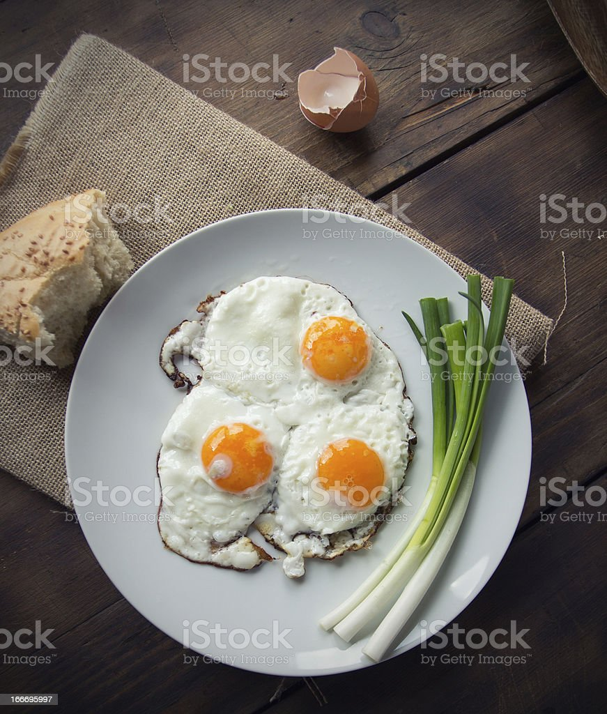 Breakfast with fried eggs and spring onion royalty-free stock photo