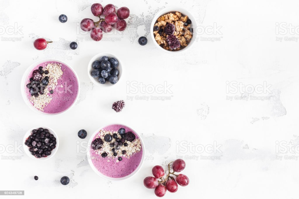 Breakfast with muesli, blueberry smoothie, fruits. Flat lay, top view stock photo