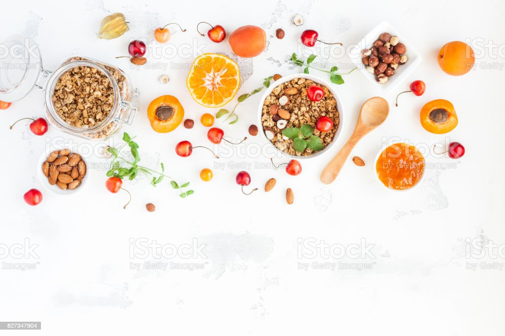 Breakfast with muesli, fruits, berries, nuts. Flat lay, top view