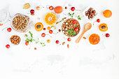 Breakfast with muesli, fruits, berries, nuts. Flat lay, top view