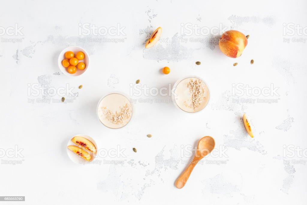 Breakfast with peach yogurt, sliced peaches, physalis stock photo