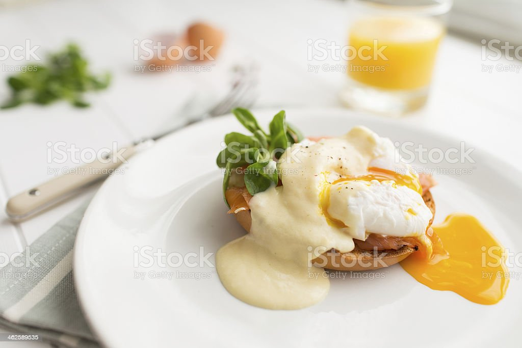 Breakfast with poached eggs royale and orange juice stock photo
