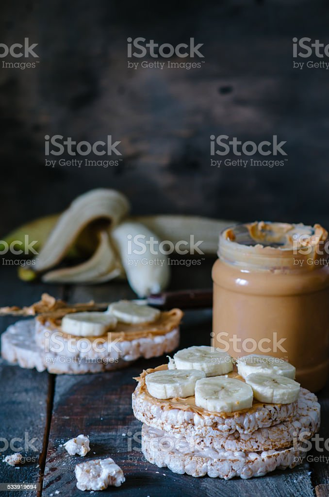 Breakfast with rice cakes, peanut butter and bananas stock photo