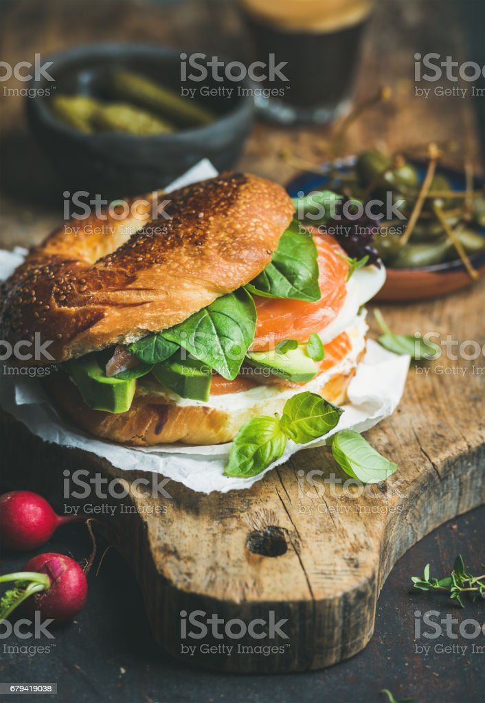 Breakfast with salmon, avocado, cream-cheese, basil bagel, espresso coffee stock photo