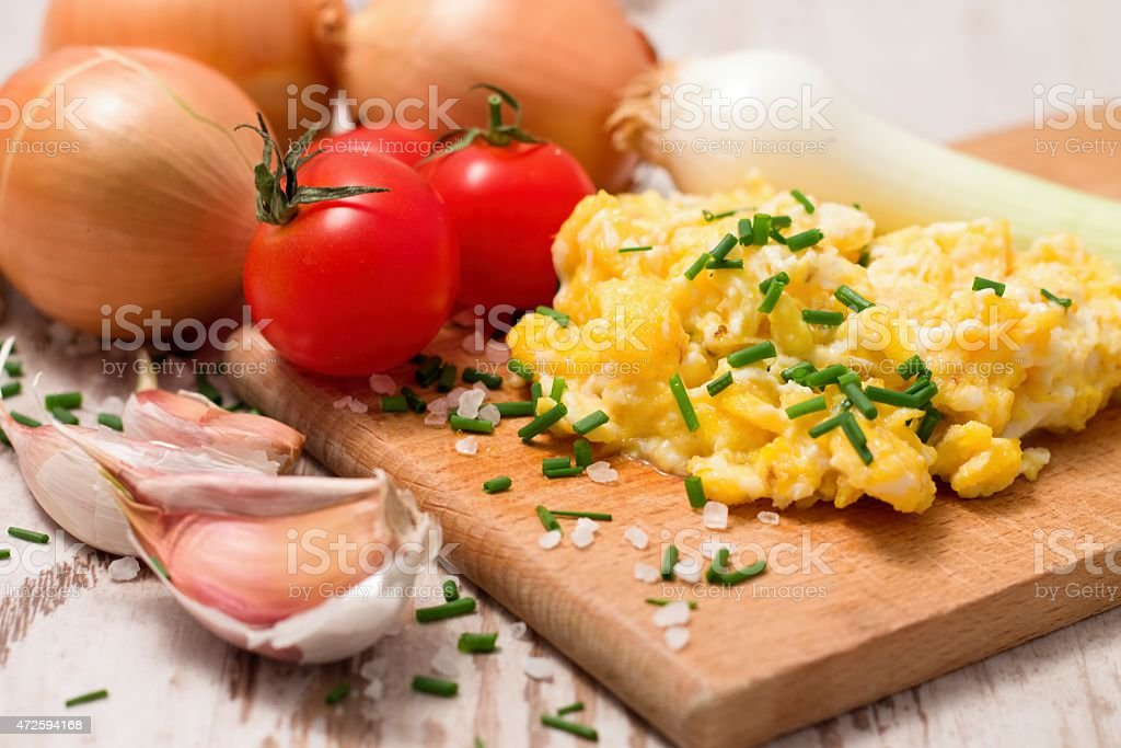Breakfast with scrambled eggs and tomatoes stock photo