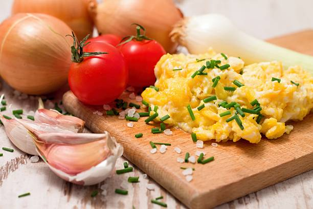 breakfast with scrambled eggs and tomatoes - onion juice stock photos and pictures