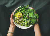 istock Breakfast with spinach, arugula, avocado, seeds and sprouts in bowl 696614682