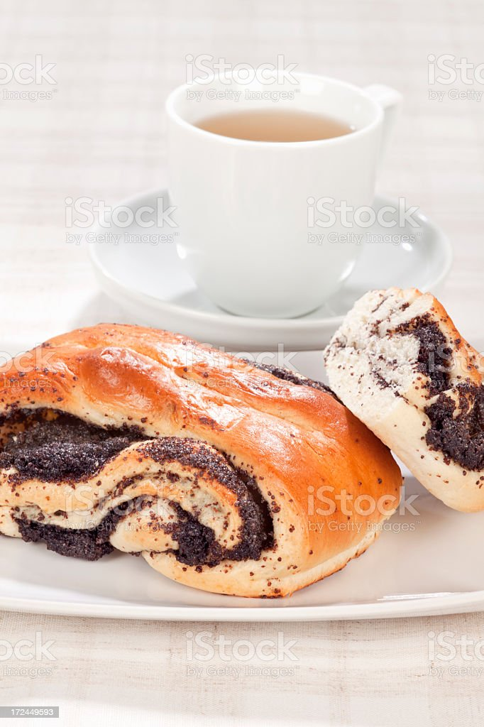 Breakfast with sweet poppy rolls royalty-free stock photo