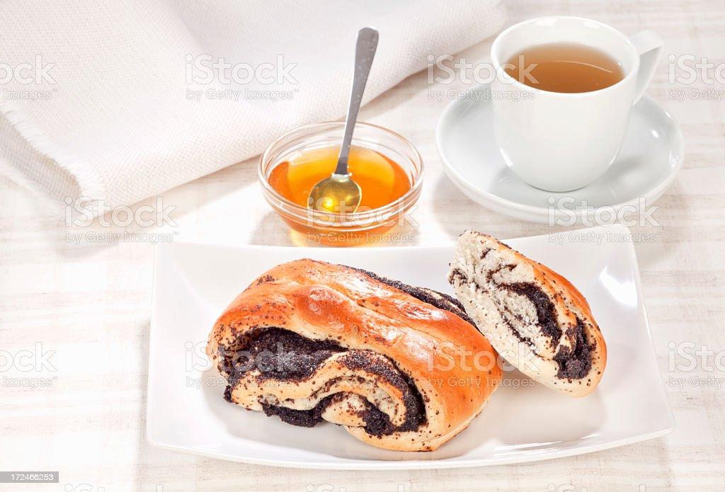 Breakfast with sweet poppy rolls royalty-free stock photo