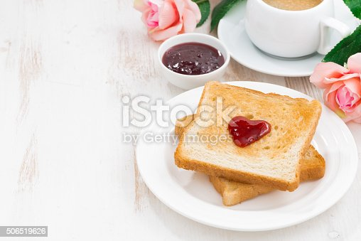 breakfast with toast and espresso for Valentine's Day on white wooden background, horizontal