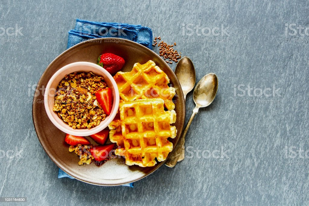Breakfast with waffles and granola stock photo