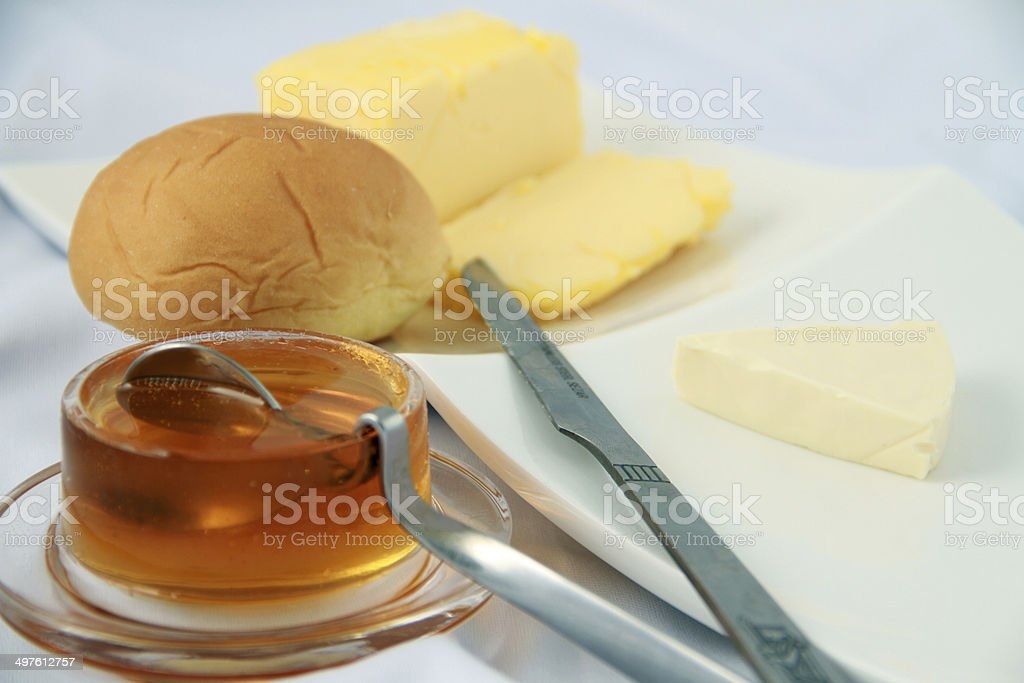 Breakfast-Honey and butter and bread stock photo