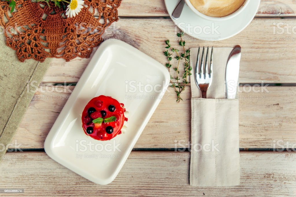 breakfest with cappuccino and cake on wooden table with fork and knife zbiór zdjęć royalty-free
