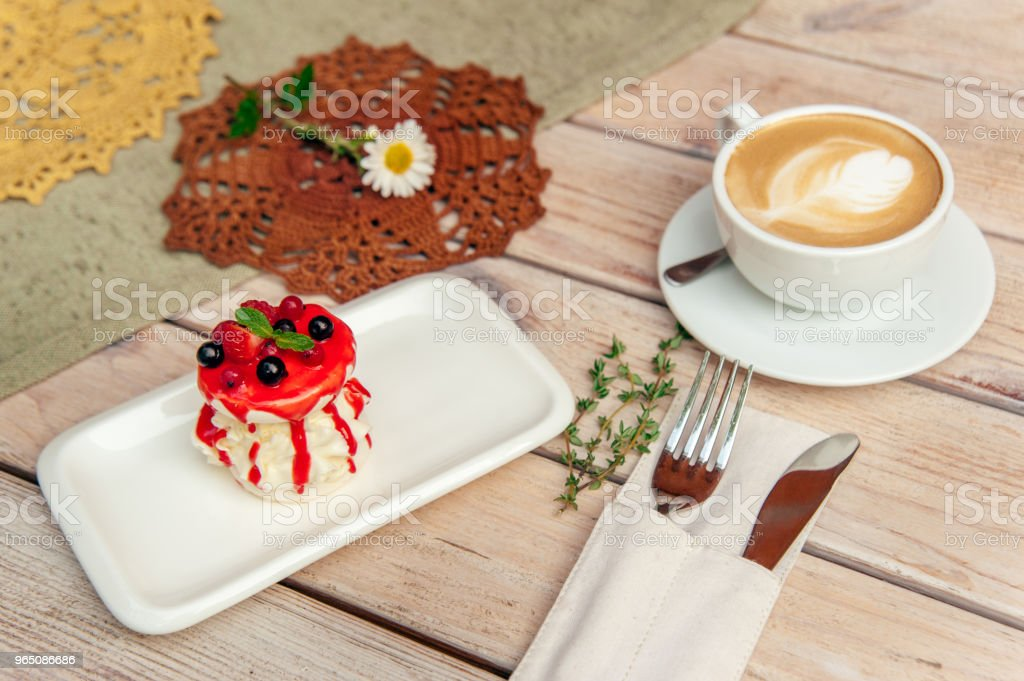 breakfest with coffee and cake on wooden table with fork and knife royalty-free stock photo