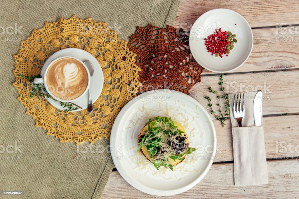 breakfest with coffee and sandwich on wooden table with fork and knife zbiór zdjęć royalty-free