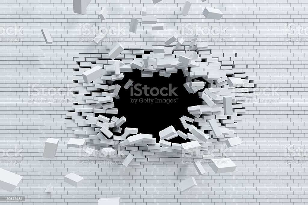 breaking brick wall stock photo