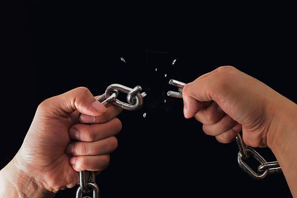 breaking chain stock photo