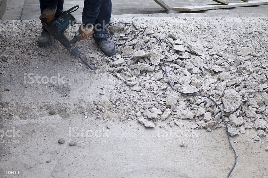 Breaking concrete with a portable drill stock photo