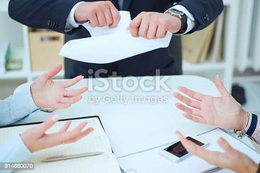 istock Breaking contract. Furious young businessman tearing up  employment contract. 914680070