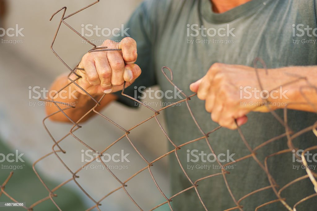 Breaking down the fence stock photo