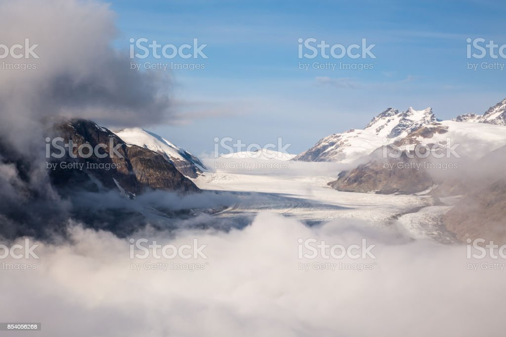 Breaking fog over Salmon Glacier in British Columbia, Canada stock photo