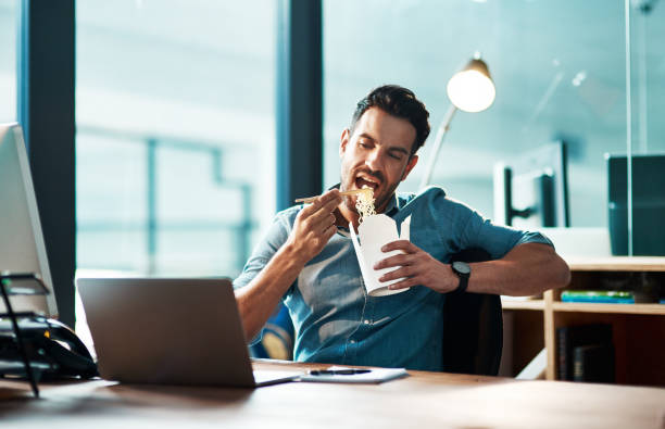 breaking for a bite - eating technology stock photos and pictures