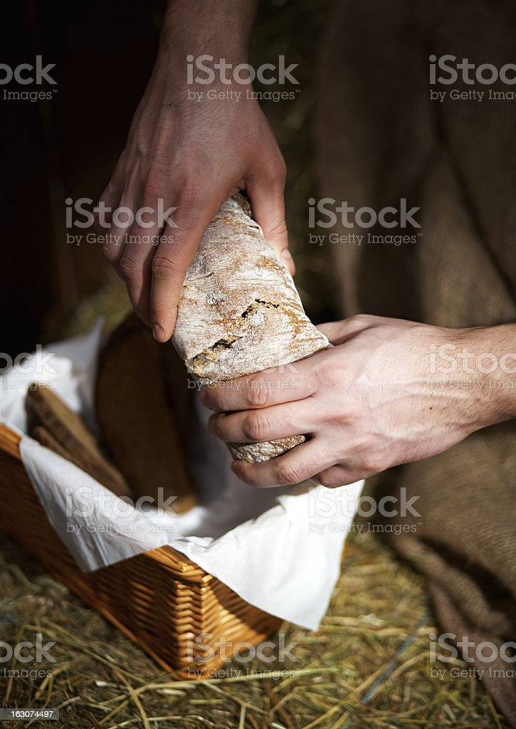 Breaking loaf of bread stock photo