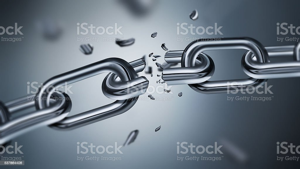 Breaking metal chain stock photo