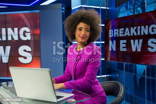 istock Breaking news female anchor 1064110400