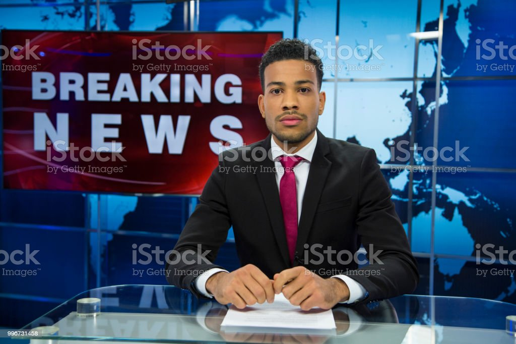 Breaking news male anchor stock photo