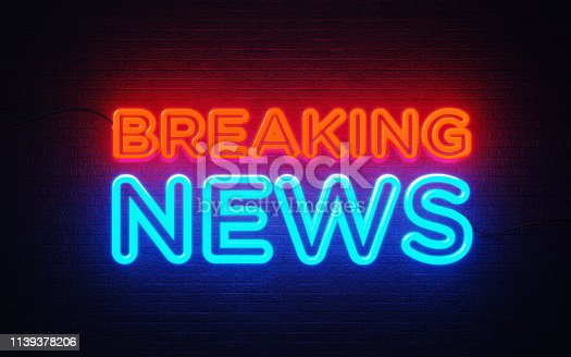 Breaking news neon light on black wall. Horizontal composition with copy space. Breaking news concept.