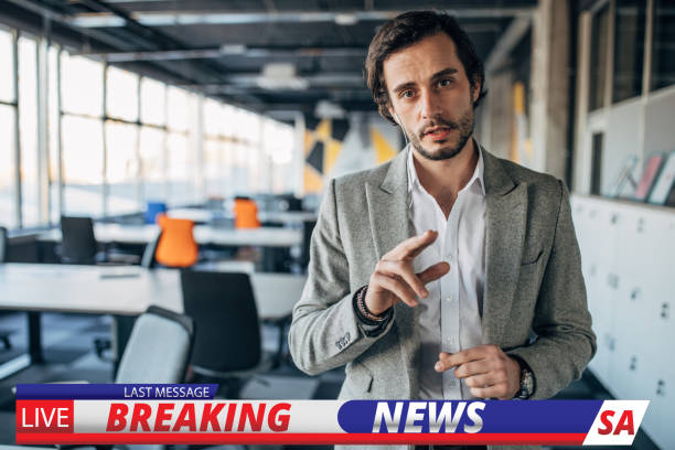Breaking news reporter One man, handsome breaking news reporter, going live in television program. sea channel stock pictures, royalty-free photos & images