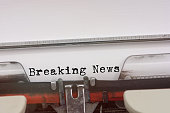 Breaking News word typed on a Vintage Typewriter.
