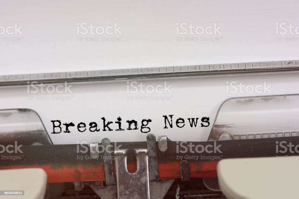Breaking News word typed on a Vintage Typewriter. stock photo